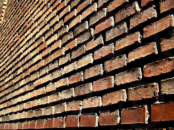 Brick wall of a house in Toledo Spain. photo