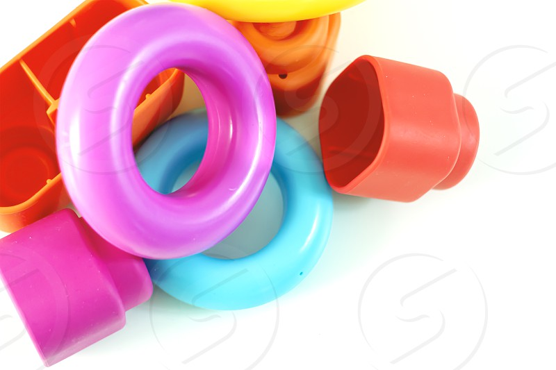 Colored plastic rings and rubber bricks for children to play. Children's toys. Growth and learning photo