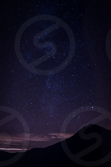 mountain silhouette at night photo