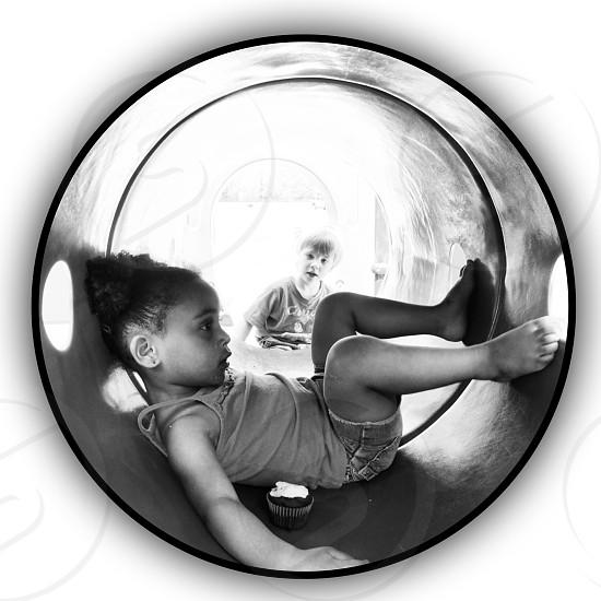 girl in grey tank top sitting photo