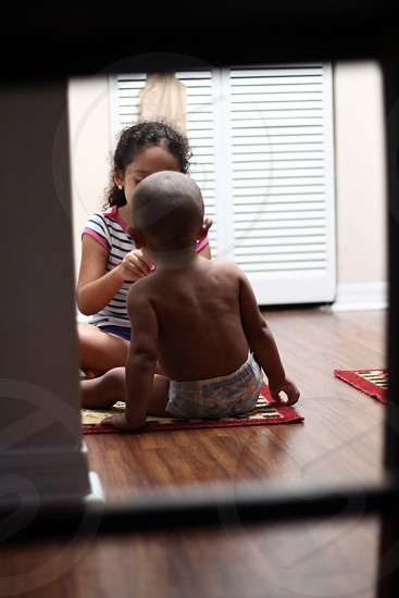 Big Sister little brother siblings feeding love cute sweetness Family kitchen floor care photo