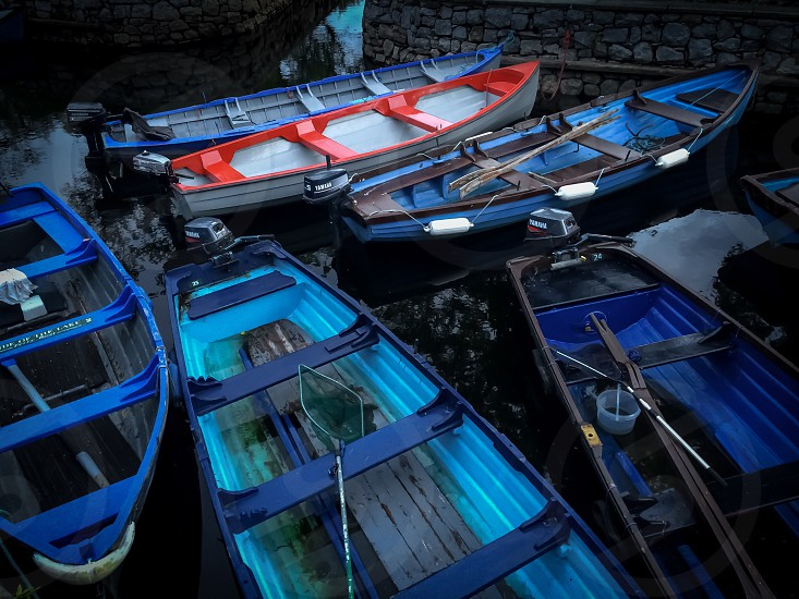 6 red and blue canoes on the water photo