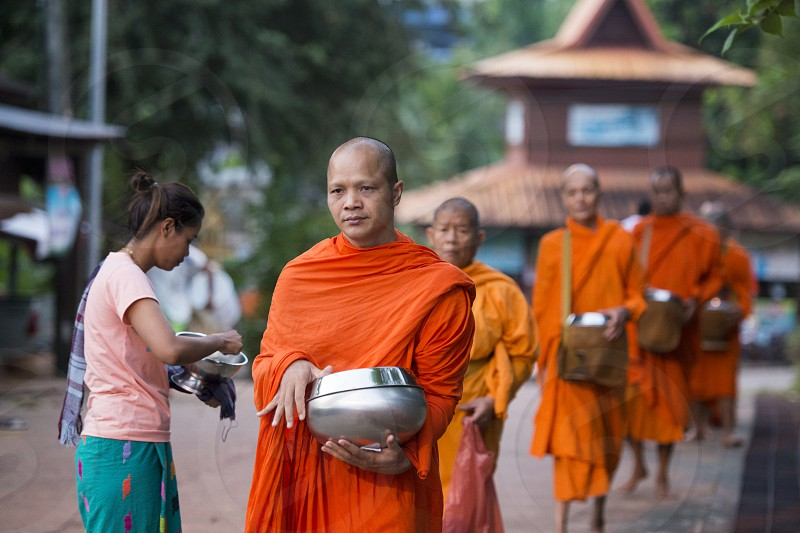 monks walking in the Village of Sangkhlaburi north of the City of Kanchanaburi in Central Thailand in Southeastasia.   photo