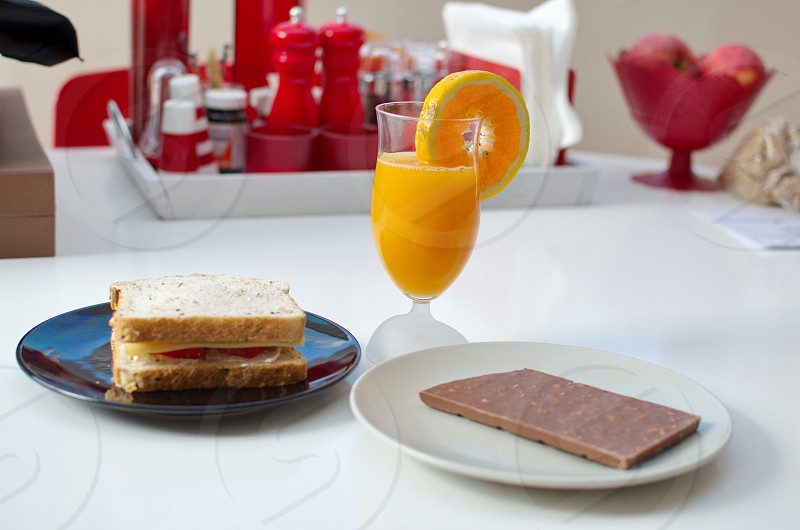 Orance Juice sandwich and chocolate for a Healthy Breakfast photo