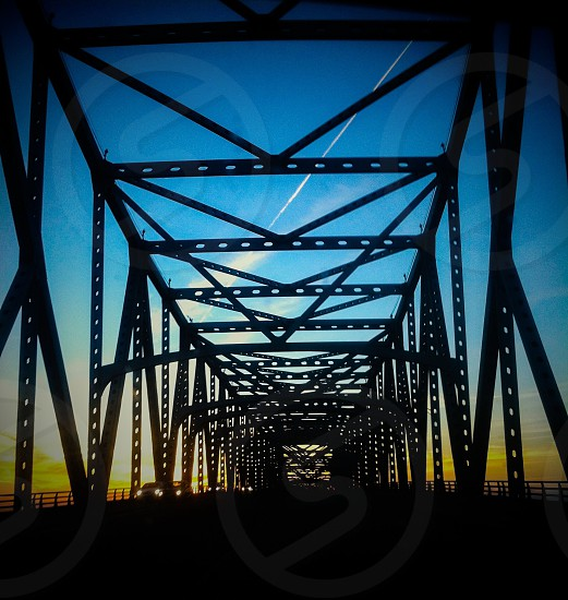 Sunset. Bridge. Road. Blue sky photo