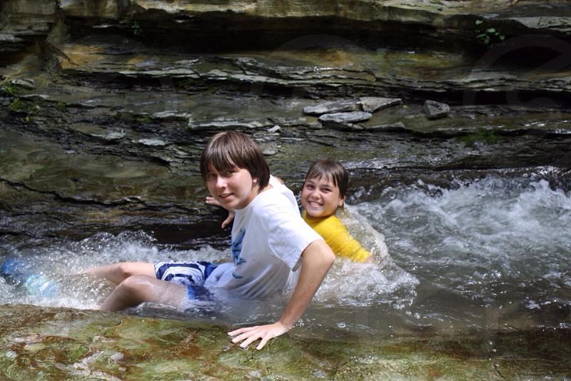 2 boys in river photo