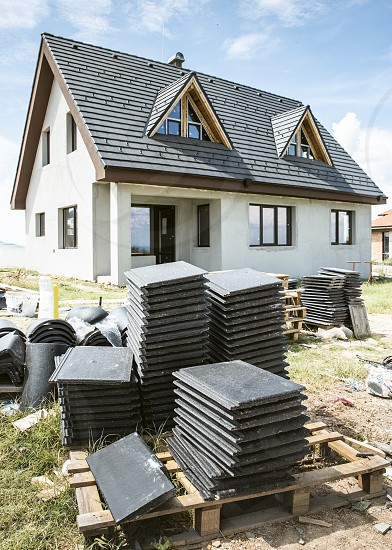 Laying roof tiles on new build house photo