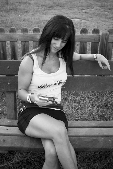 Pretty girl with her mobile phone photo