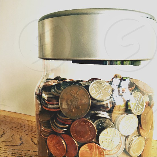 A container of coins (piggy bank) photo