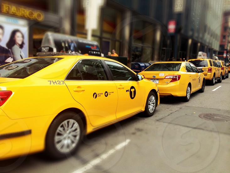 yellow taxi cab on parked photo