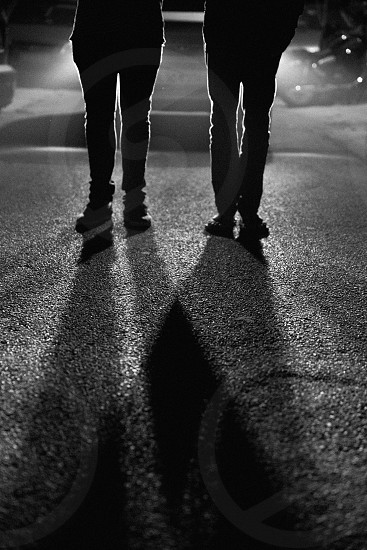 2 person standing on road in black and white image photo