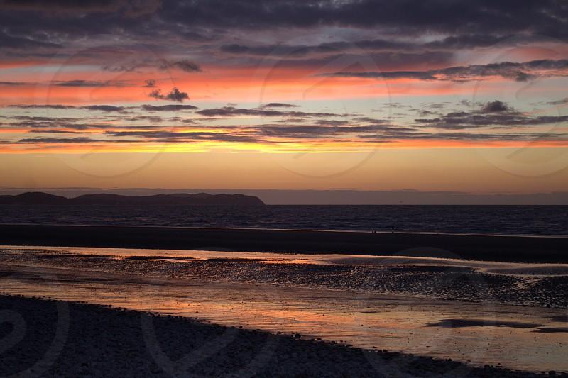 Pensarn Beach at sun set looking towards the Great Orm.. photo