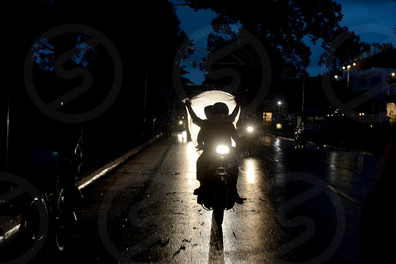 a Morobike by rain at a road  in the City of Siem Reap in the west of Cambodia.   Cambodia Siem Reap April 2014 photo
