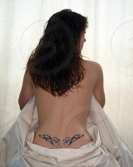Beautiful woman with tattoo photo