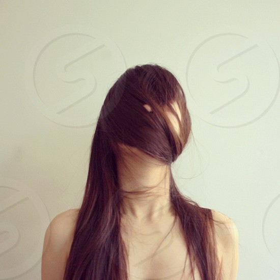 woman with hair covering face photo
