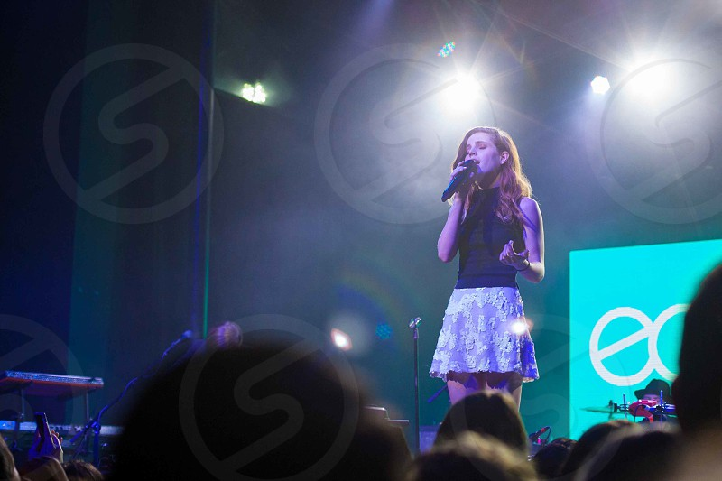 woman singing on stage photo