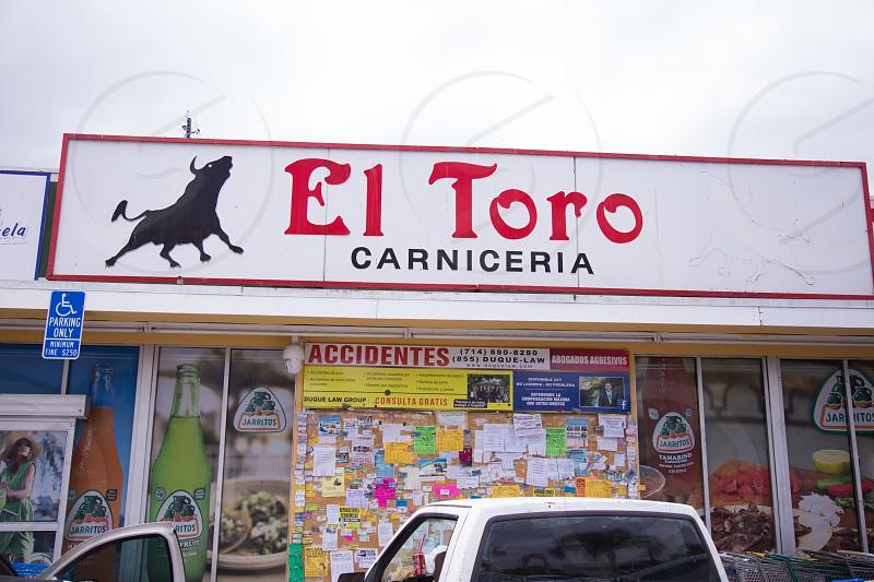el toro carniceria near white pick up truck photo