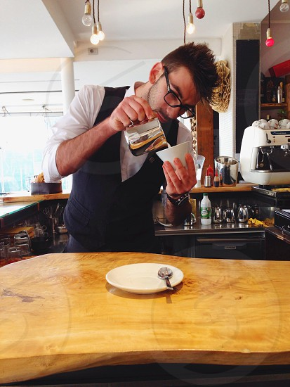 Barman making cappuccino  photo