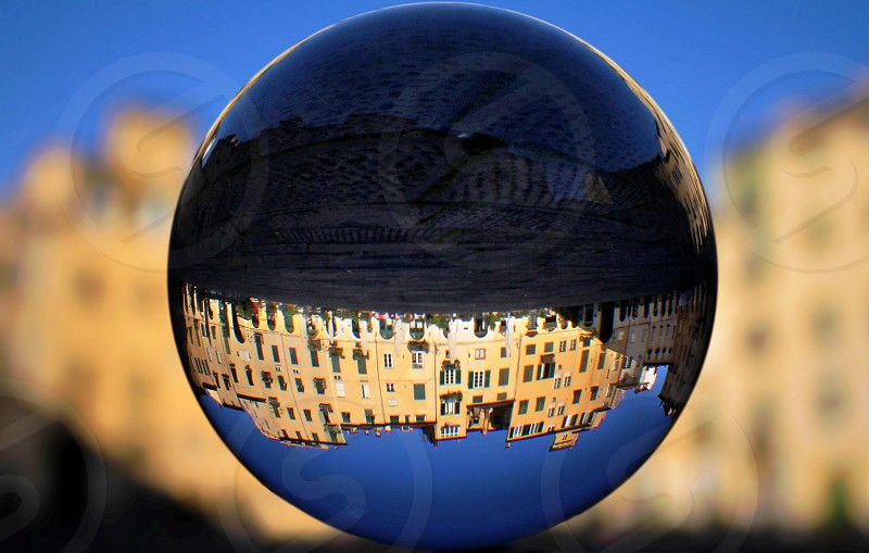An old town reflected inside a crystal ball photo