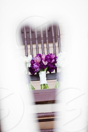 Flowers through heart shape railing photo