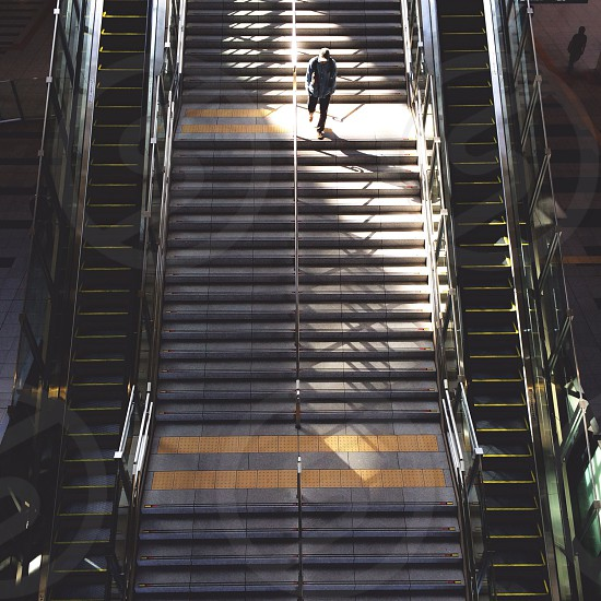 man walking on stairway photo