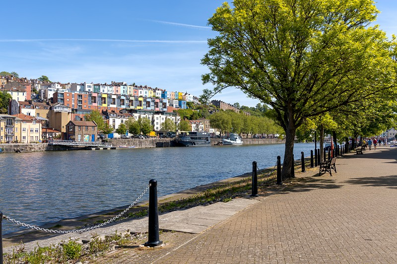 BRISTOL UK - MAY 14 : View of boats and colourful apartments along the River Avon in Bristol on May 14 2019. Unidentified people photo