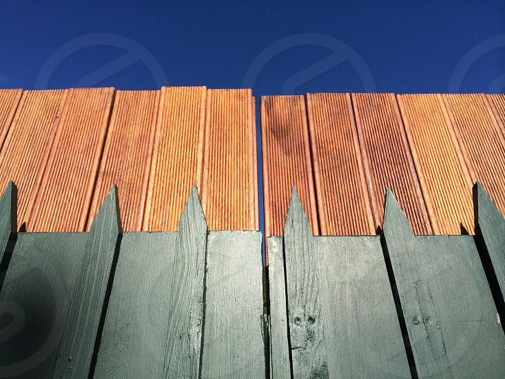 A fence against a dazzling blue sky in Richmond a suburb of Melbourne. photo