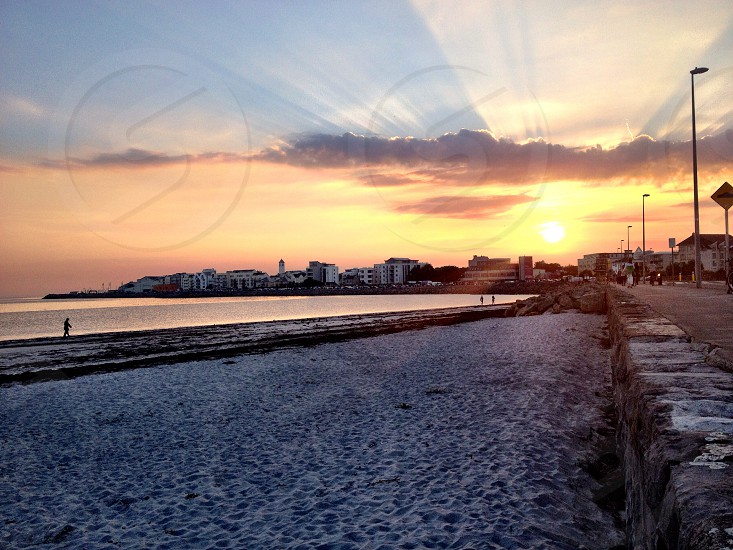 Sunset over Salthill prom Galway Ireland! A great evening for a run on the beach!  photo