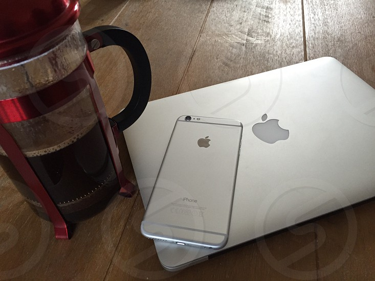iphone and macbook and french press photo