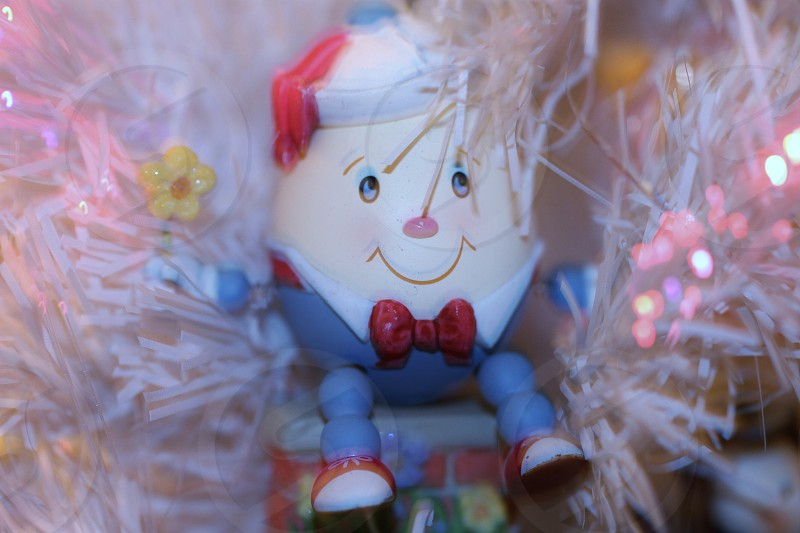 white and blue humpty dumpy toy photo