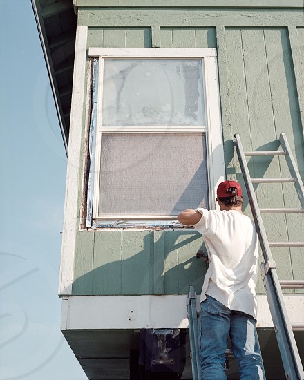 Man construction repair home sky window photo