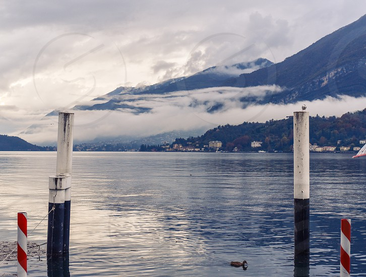 lake como italy northern italy milan tuscan europe romantic lake villa fog dock  photo
