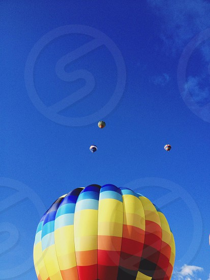 blue yellow black and red hot air balloon on sky photo