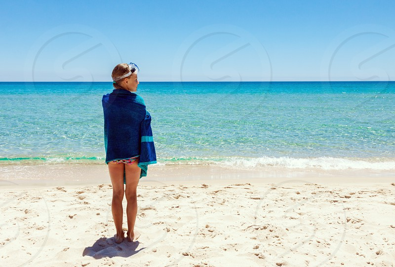 girl beach sea ocean summer escape lonely landscape outdoors child vacations travel person photo