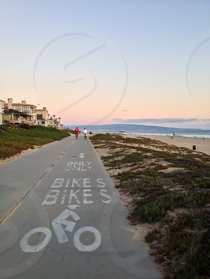 Bicycling along the beach at sunset. photo
