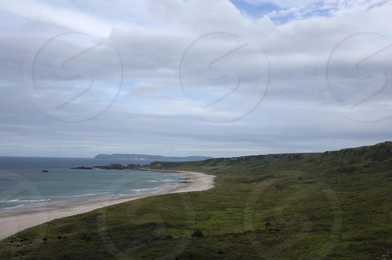 Antrim Coast Road Northern Ireland Irish Sea Autumn Bay Rocks Cliffs Beach photo