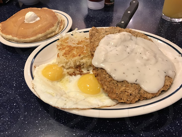 Chicken steak and hash brown and a side of pancake photo