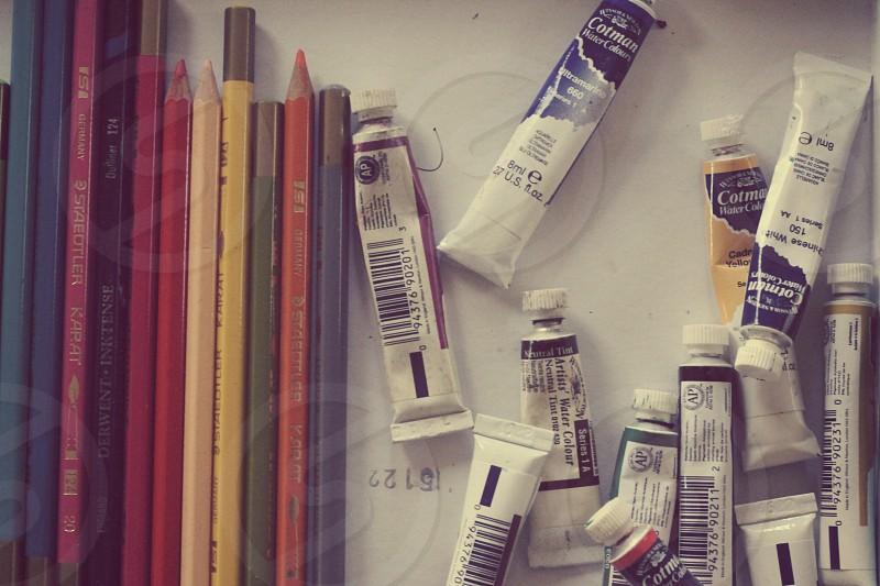 Colors paints pencils art supplies. photo