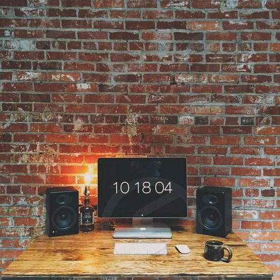 black speaker on table photo