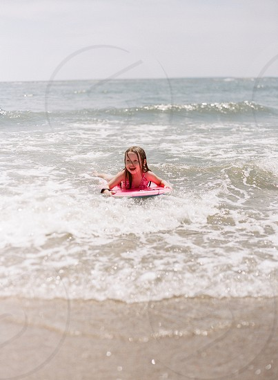 Boogie board beach ocean beach lifestylelittle girl kids summer break summer fun water vacation photo