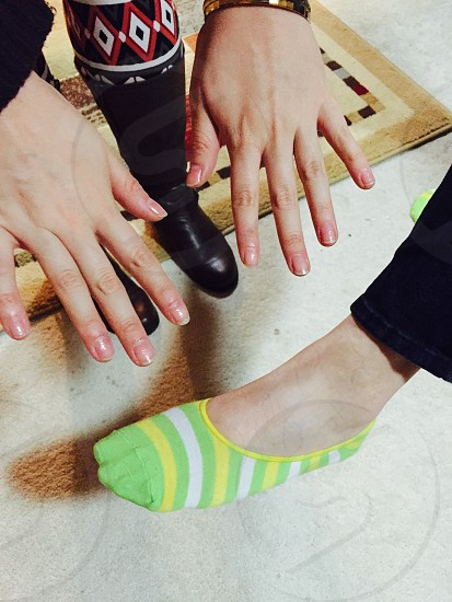 Girls weekend! Sparkly nails and colorful socks.  photo
