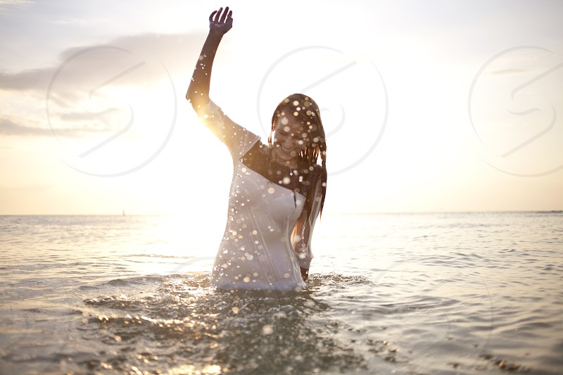 woman in white tank top in water photo