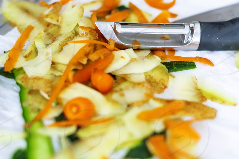 Vegetable peels of carrots potatoes and zucchini freshly peeled with a peeler. Concept of food and healthy lifestyle. photo
