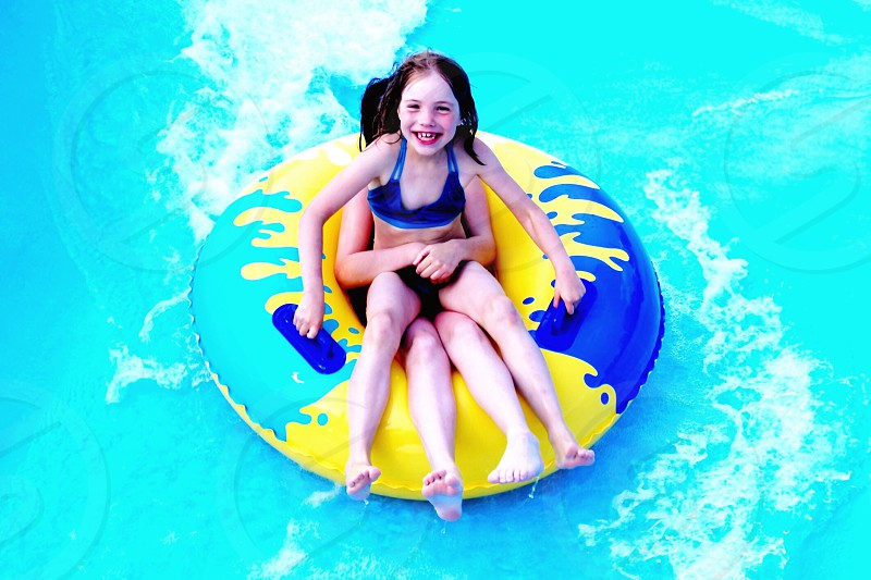 2 girls on swimming pool photo