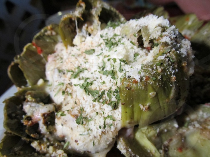 Baked and stuffed artichoke with cheese photo