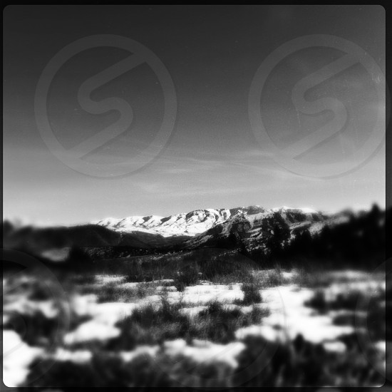 snow covered mountain grayscale photo