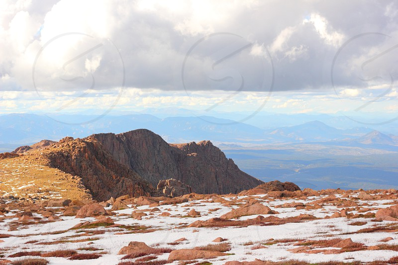 Colorado Sky clouds mountains snow outside outdoors rocks high cold pikes peak view photo