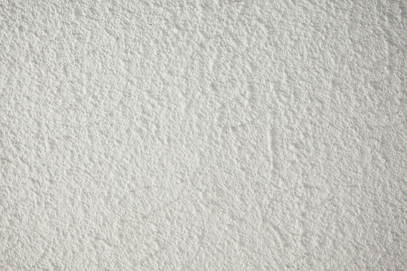 Texture of an old white wall closeup view. photo