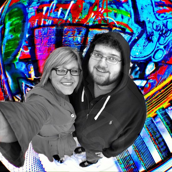 Friends and Walls - rainbow wall with a man and a woman photo