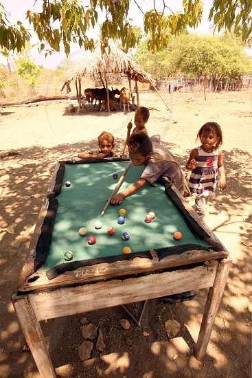 childern play billard at the village of Hato-Udo in the south of East Timor in southeastasia. photo